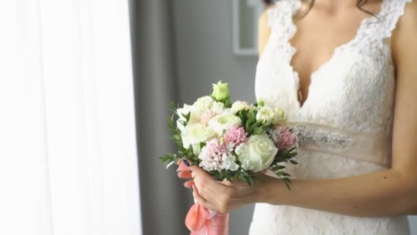 beautiful bride smelling wedding bouquet
