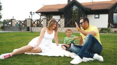 Beautiful family having fun on the lawn