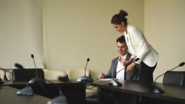 Elegant secretary bringing some documents for signature to her boss