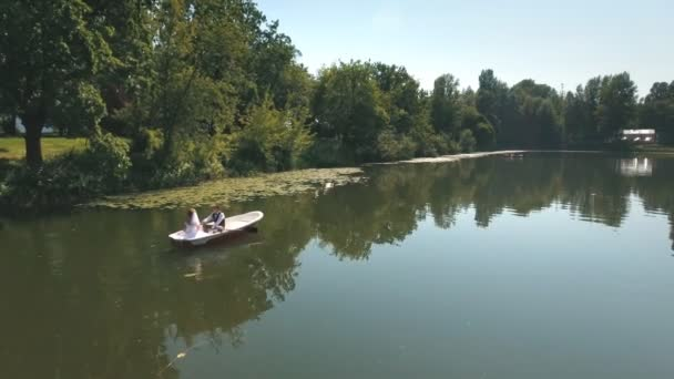 aerial view on Couple is floating on a boat on the lake in wood