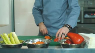 chef cooking food kitchen restaurant cutting pepper
