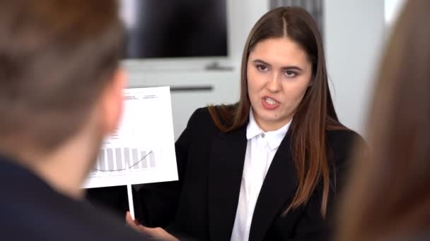a businesswoman shows a good statistical report