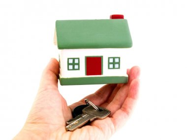 Miniature houses mortgage and real estate investment or property insurance