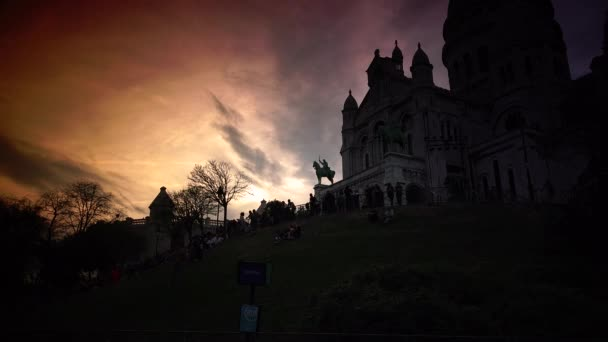 PARIS, FRANCE ,circa May 2016 : spectacular sky at the sunset with the Basilica Sacre Coeur in Montmartre, Paris, ULTRA HD 4k, time lapse