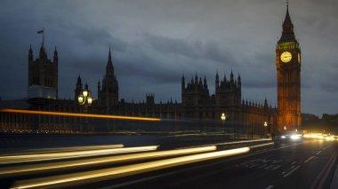 LONDON, UK - APRIL: Traffic and pedestrians on Westminster Bridge near Big Ben and Parliament