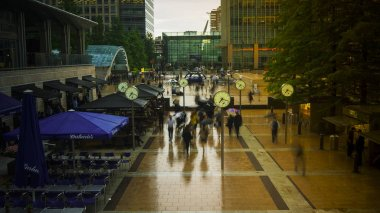 LONDON, Uk - JUNE 04: Commuters rushing to work in Canary Wharf, the financial district of London, England.