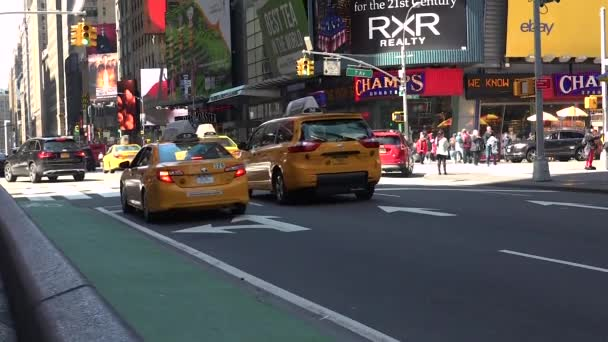 NEW YORK CITY - May 9:Times Square in New York, traffic cars and pedestrians in slow motion