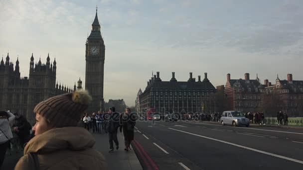 LONDON, UK -  circa 2017: Vehicle and foot traffic near Big Ben in London, UK.ultra hd 4k, real time