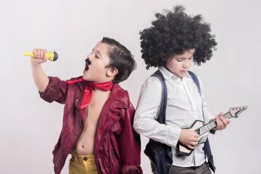 Children disguised as rock stars