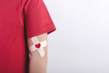 Child with a heart drawn on his arm. Blood donation concept