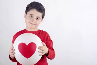 Smiling child with a heart