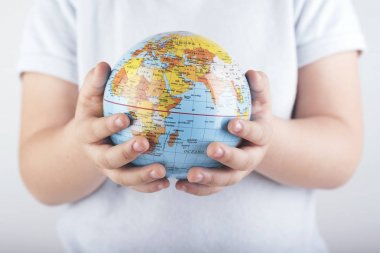 child with a world globe in His Hands