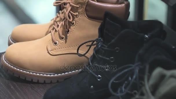 Clothes store, showroom, winter boots closeup