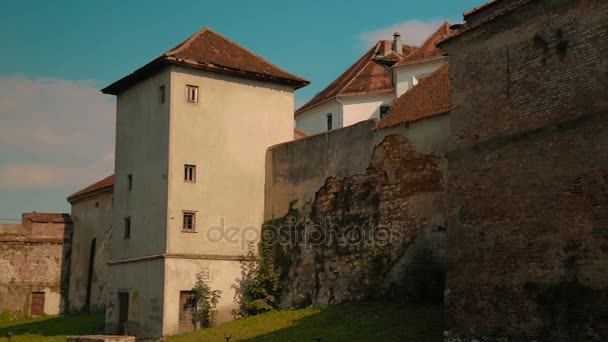 Panning shot showing rear detail of the Old Citadel in Brasov, Romania