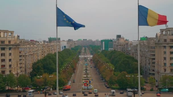 Establishing shot of the Liberty Avenue in Bucharest with the Romanian and EU flags visible