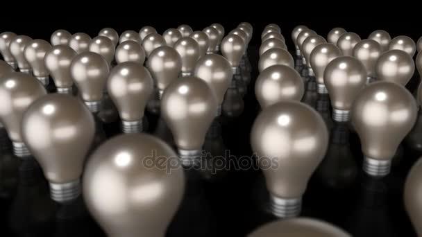 brillante Idee - eine 3D-Animation, die eine Reihe flackernder Glühbirnen mit einer größeren Erhöhung zeigt und über dem Rest leuchtet