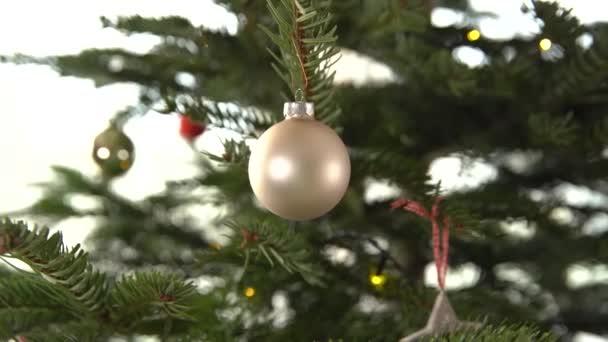 Silver glass ball on Christmas tree