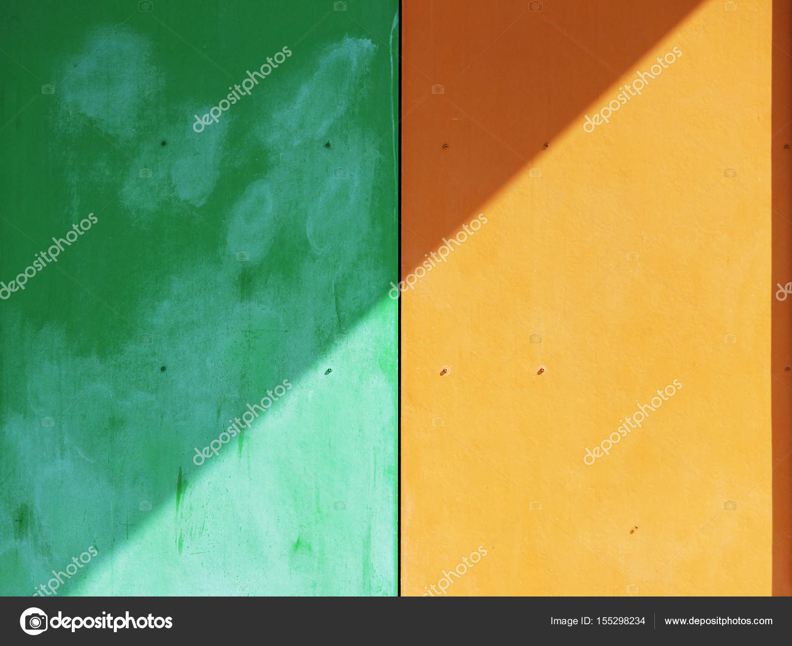 The wall of the house, trimmed with colorful panels, painted in ...