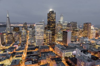 Moonshine over San Francisco Downtown. Aerial view of San Francisco Financial District as seen from a building rooftop in Nob Hill.