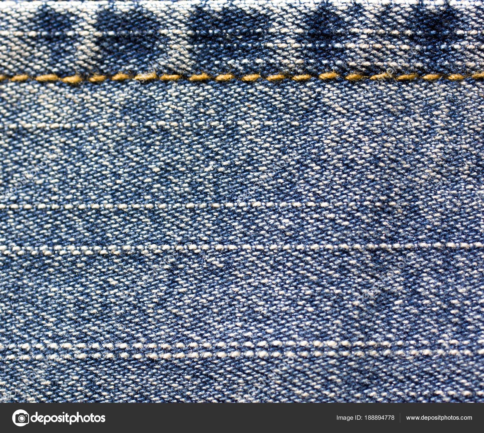 Blaue Jeans Stoff nähen mit orange-thread — Stockfoto © Yulu #188894778