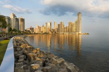 View of the financial district and sea in Panama City, Panama, at sunset.