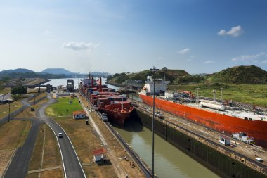 Cargo ship and a oil tanker in the Miraflores Locks in the Panama Canal, in Panama