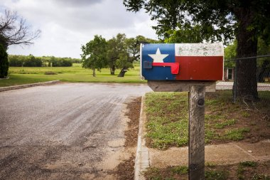 Mailbox painted with the Texas Flag in a street in Texas