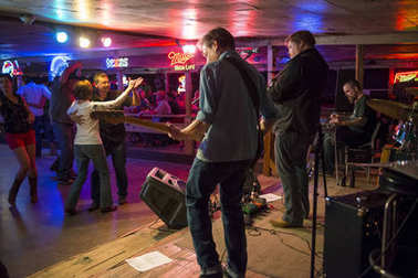 Austin, Texas - June 13, 2014: Country music band playing and people dancing in the Broken Spoke dance hall in Austin, Texas, USA