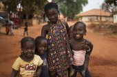 Nhacra, Republic of Guinea-Bissau - January 28, 2018: Portrait of a smiling group of children in the town of Nhacra in Guinea Bissau, West Africa