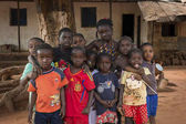 Nhacra, Republic of Guinea-Bissau - January 28, 2018: Portrait of a group of children in front of a house in the in the town of Nhacra, Guinea Bissau.