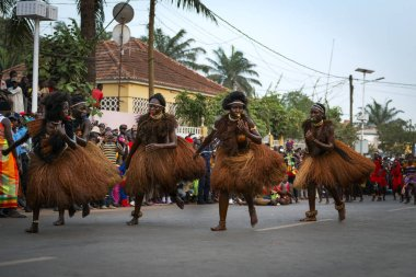 Bissau, Republic of Guinea-Bissau - February 12, 2018: Group of beautiful young girls dancing during the Carnival Celebrations in the city of Bisssau.
