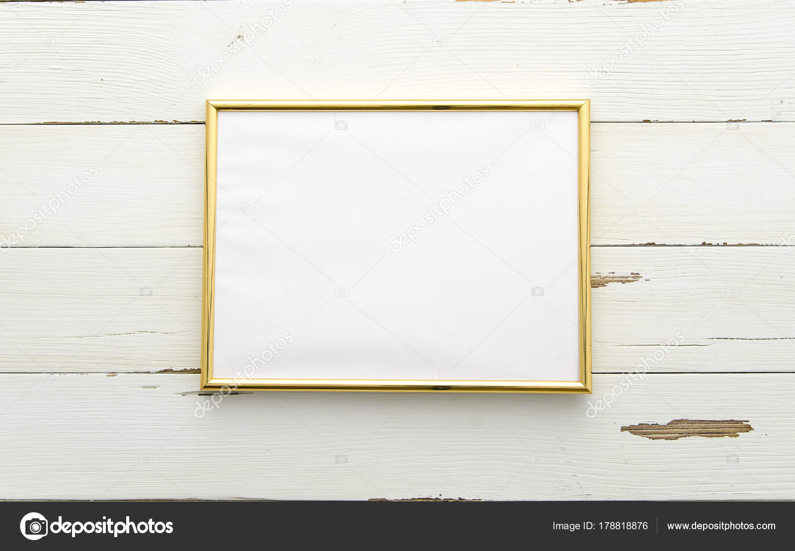 Golden photo frame for painting or picture on white wooden ...