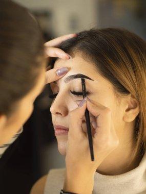 Eyebrow lamination process in the salon. Beautiful new eyebrow shape