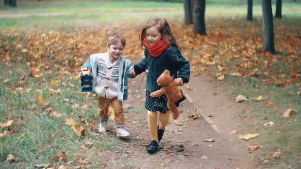 Cute Brother And Sister Little Boy And Girl Running Holding Hands