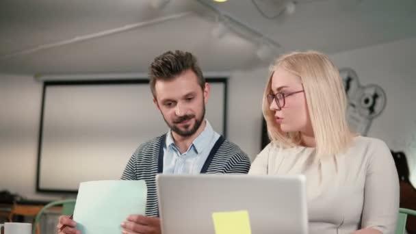 Diverse people group teamwork using digital display technology. Creative business team meeting in modern start up office