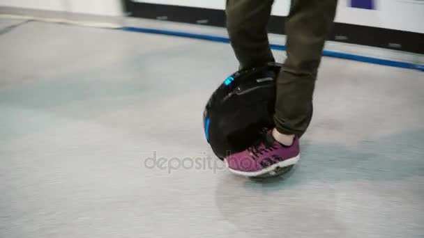 .Close-up of boy legs riding solowheelsegway - electric unicycle. 4K