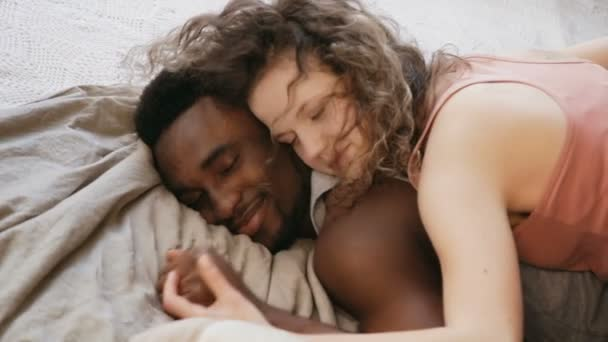 Romantic Morning Of Multiethnic Couple Woman Lying On Man The Bed And Hugging