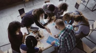Business meeting at modern office. Top view of multiracial group of people working near the table together.