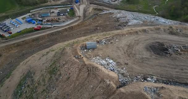 Copter turning around the city dump and waste management plant. Aerial view of the pile of trash outside the city.