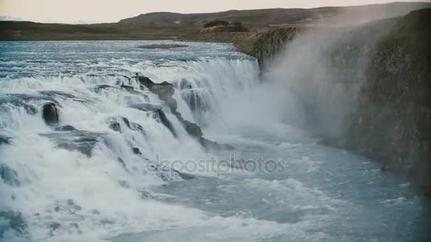 Beautiful landscape of the mountains and water. View of the amazing Gullfoss waterfall in Iceland.