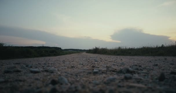 Sportsman running towards rural sunset panorama. Freedom. Back view on quiet autumn road. Cinematic ending steady shot.
