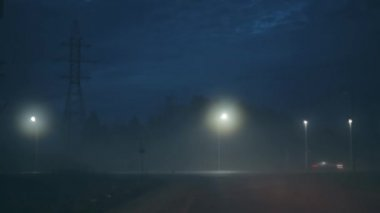 A car turning to amazing dark night highway. Incredible atmospheric cinematic shot. Scenic sky and bokeh city lights.