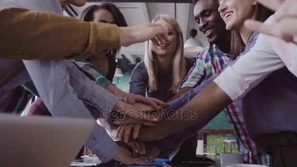 Close-up view of young business team puts palm together Two mans fist greeting each other. slow mo