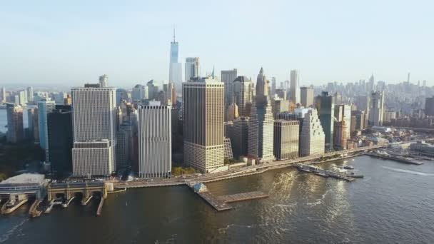 Aerial view of New York, America. Drone flying away from the Manhattan district, downtown on the shore of East river