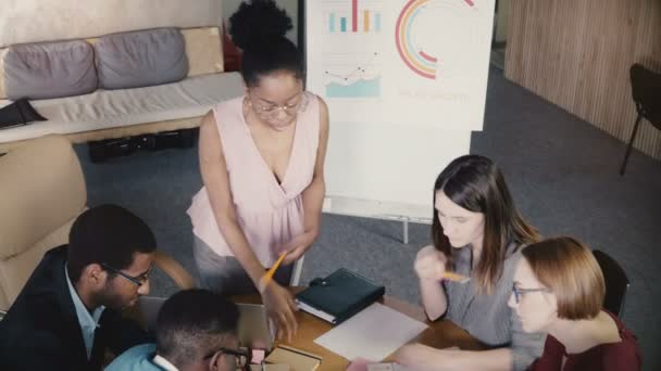 African American woman boss motivates colleagues. Successful businesswoman gives directions at office team meeting 4K.