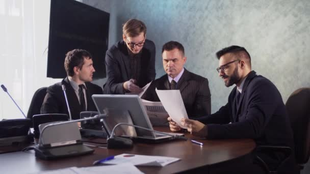 business people having a meeting conference talking about future success of the company. modern city office   interior, group of four business man working on laptop at meeting together in room