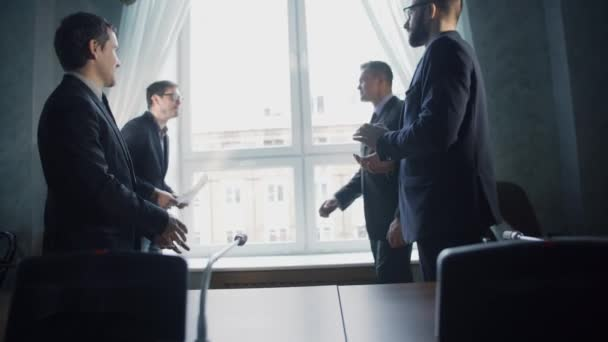 businessmen shaking hands and agreeing on new project in modern office