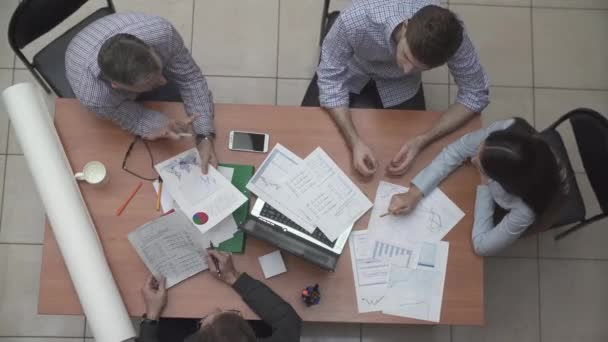 Businessmen that work together in office. Concept of teamwork and partnership working in office top view