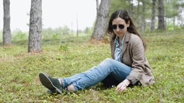 young woman relaxing in park outdoor after work