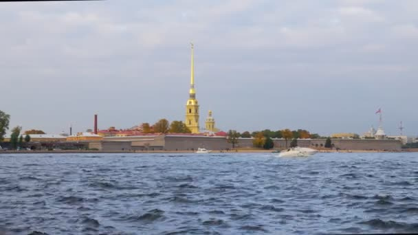 pleasure ships are floating near Peter and Paul Fortress, waves of river in foreground